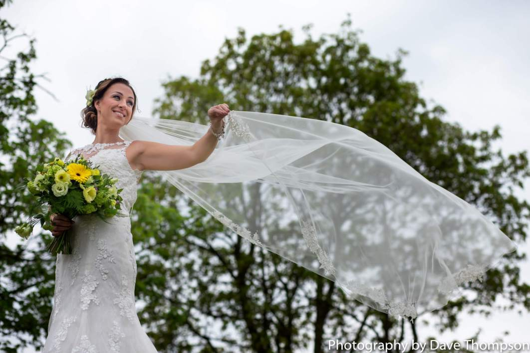 A bride waves her veil