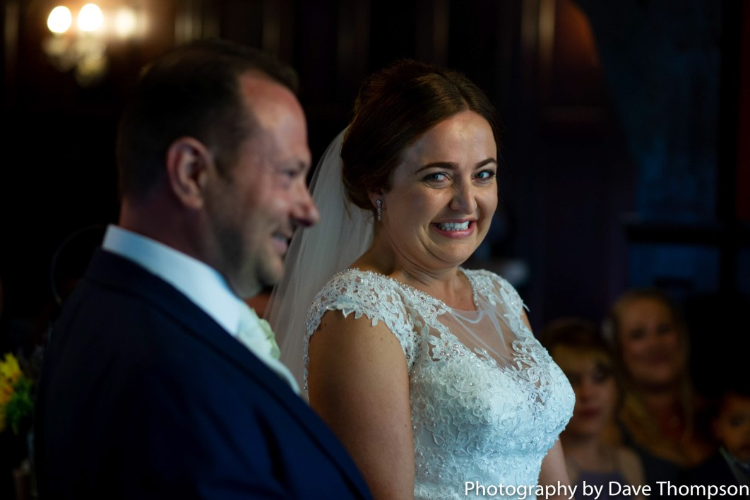 The bride smiles during the ceremony