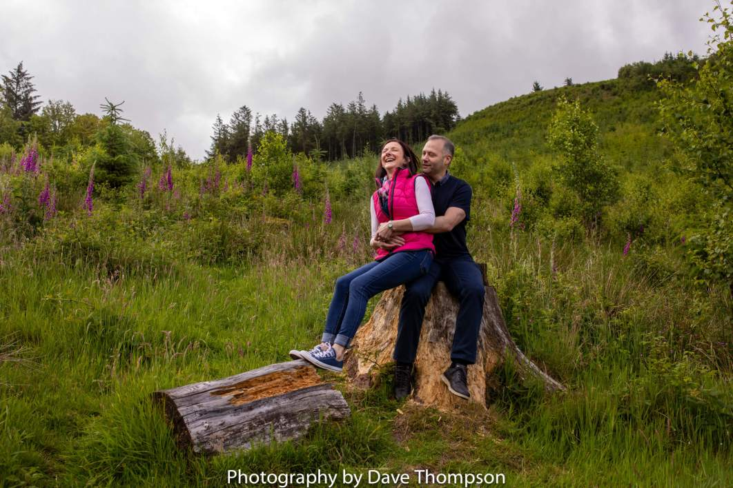 A couple on a log at Macclesfield Forest