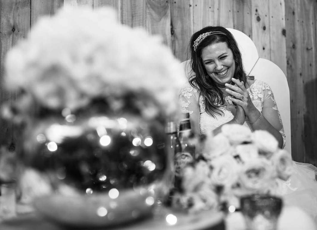 The bride laughs during the speeches