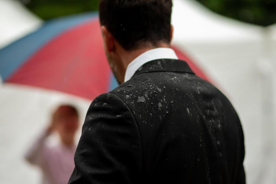 a Wedding guest and his soaked suit.