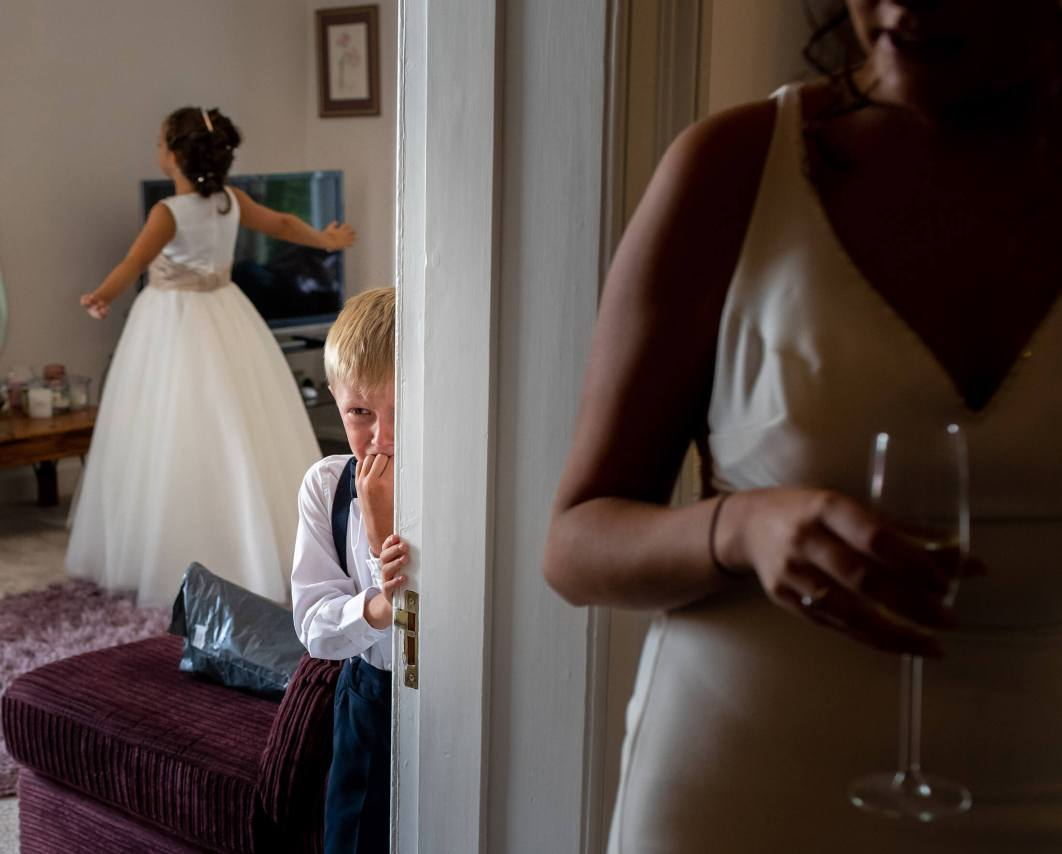 A young boy cries during bridal prep.