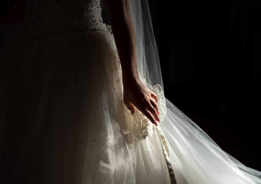 Detail shot of the sunlight as it catches the bride dress at Hollin Hall Hotel in Cheshire