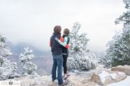 Couples looking off into a snowy Grand Canyon just east of the El Tovar Hotel