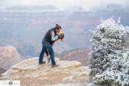 Couples Portraits with snow covered Grand Canyon