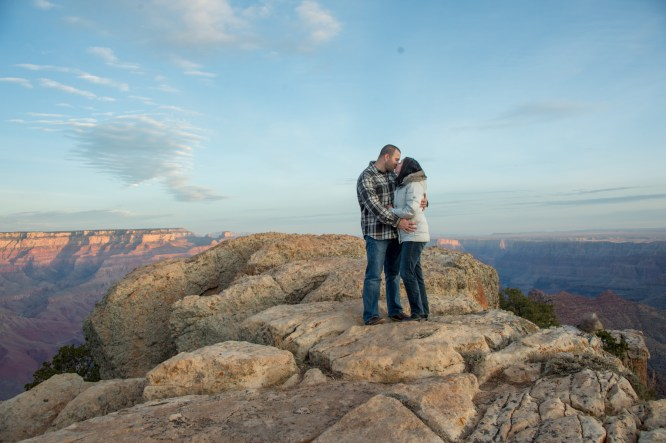 kiss on the edge of grand canyon - newly engaged