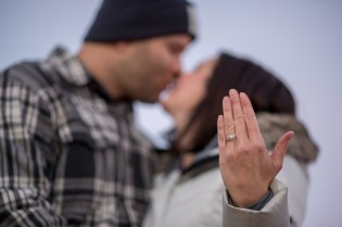 Engagement ring kiss photo at Grand Canyon