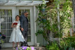 Father of the Bride takes her down the aisle