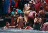 Nepaliese women bathing in Bagmati River, Kathmandu, Nepal, 1984Rejoicing in the renewal of life that the monsoon brings, women gather at the Baghmati River in Kathmandu for a ceremonial bath. They honor Parvati wife of the Hindu God Siva, who dwells among the peaks and sends the streams cascading to the plains.National Geographic: Priit J. Vesilind. Monsoons: Life Breat of Half of the World (December 1984, vol 166(6)), 712-747Women give thanks for the renewing rains through ritual washing in the Baghmati River. Teej festival, Kathmandu, Nepal.