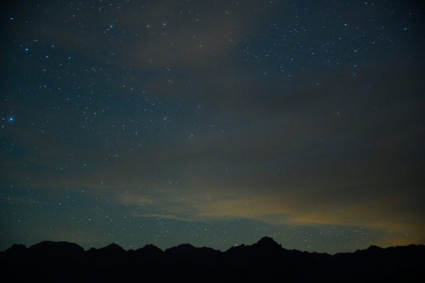 Telephoto image of the stars at night with 20 seconds of exposure, showing star trails from focal length