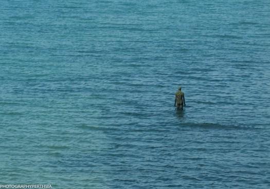 man in the sea as tide coming in (1 of 1).jpg