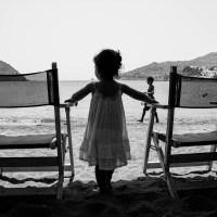 A little girl gazing the sea