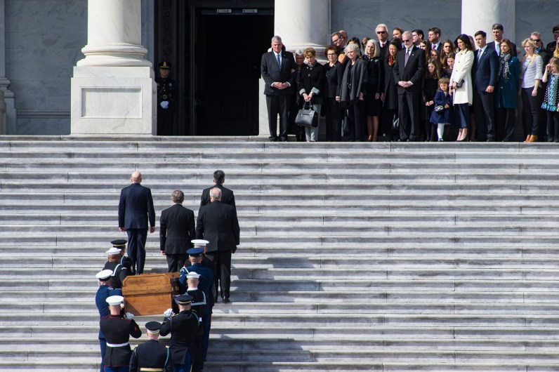 Rev Billy Graham's casket carried up the Capitol steps so that is body may lie in honor as his family awaits him at the top of the stairs, Feb 28, 2018
