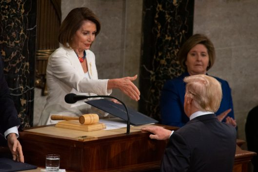 House Speaker NANCY PELOSI greets President DONALD TRUMP prior to his State of the Union address, February 5, 2019