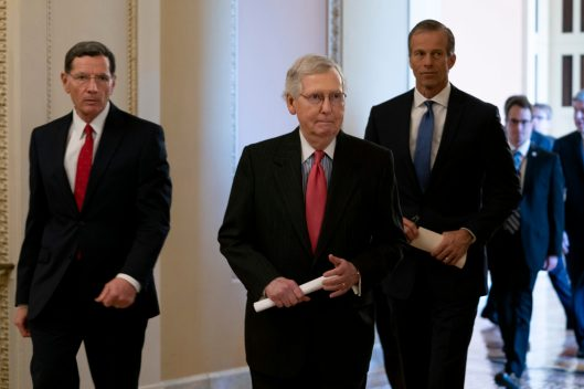Senate Majority Leader MITCH MCCONNELL (R-KY) flanked by Senator JOHN BARRASSO (R-WY) and Senator JOHN THUNE (R-SD) walking to the Senate Republican Leadership News Conference, Tuesday February 5, 2019