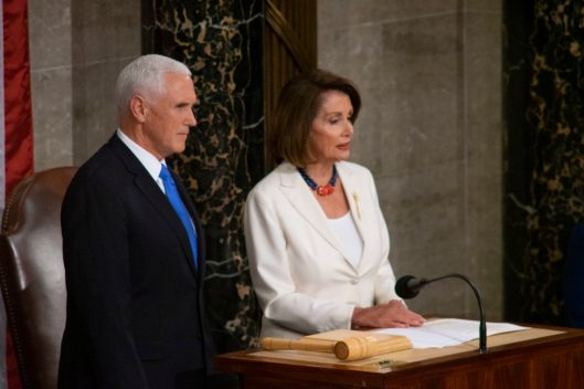 Vice President MIKE PENCE and House Speaker look on as DONALD TRUMP gives the State of the Union address, February 5, 2019