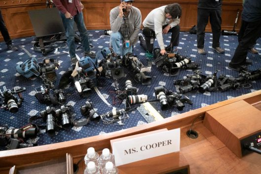 An array of cameras scattered about the hearing room floor to mark photographers' spaces where they will stand when Laura Cooper and David Hale enter to testify before the House Intelligence Committee, November 20, 2019