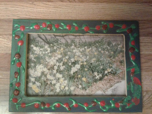 I used acrylic tipped paint to create a rose design on a wooden picture frame.