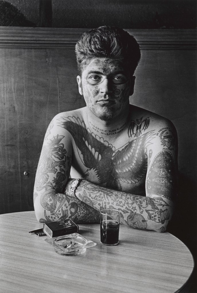 Diane Arbus. Jack Dracula at a bar, New London, Conn. 1961.