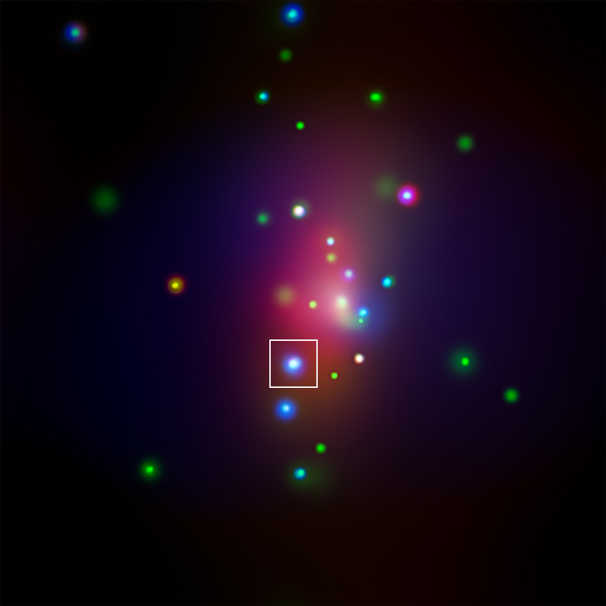 This image from NASA's Chandra X-ray Observatory shows spiral galaxy NGC 7331, center, in a three-color X-ray image. Red, green and blue colors are used for low, medium and high-energy X-rays, respectively. An unusual supernova called SN 2014C has been spotted in this galaxy, indicated by the box in Figure 1.