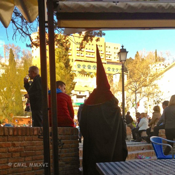 A nazareno hastening past our bistro table ...