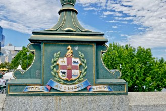 """""""She Gathers Strength As She Goes"""" Melbourne motto & flag"""