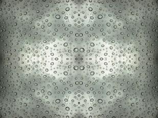 Droplet pattern: rain on moon-roof. Photo taken near Tuolumne Meadows, Yosemite National Park, of rain on glass roof of car.