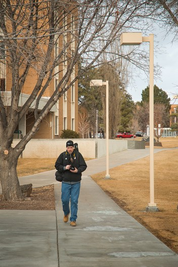 Photo media student, Ed Ritterbush, walks across campus while on assignment, Thursday, Jan. 30, 2014, in Pocatello, Idaho. Ritterbush engaged strangers on the street as part a journalistic exercise at Idaho State University. (ISU Photo/Terry Ownby)