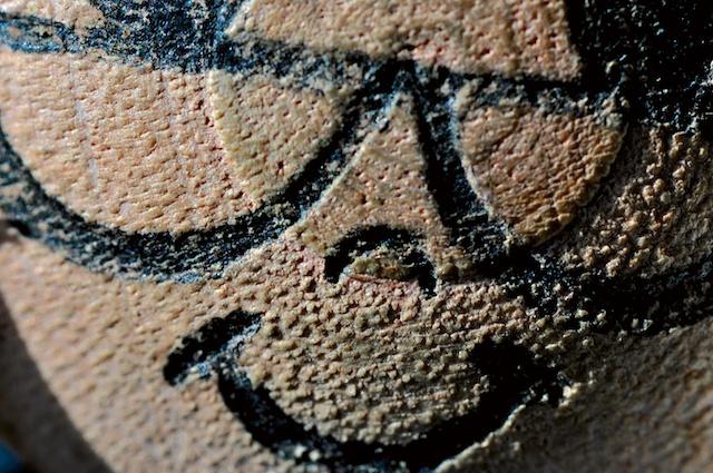 Macro close-up of wooden Grandma toy figure