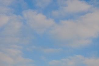 Wispy, pink-clouded blue sky