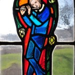 Stained Glass portait of Stephen Foster, playing a flute