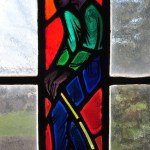 Stained glass depicting a presumably African-American character from Stephen Foster's songs, full character standing