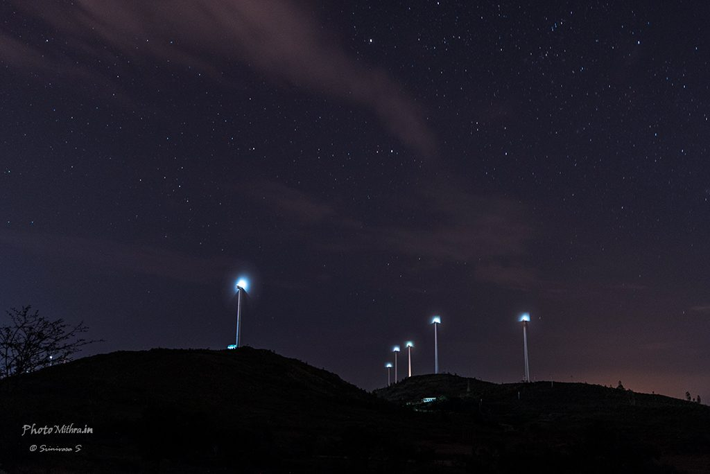 Windmills at night
