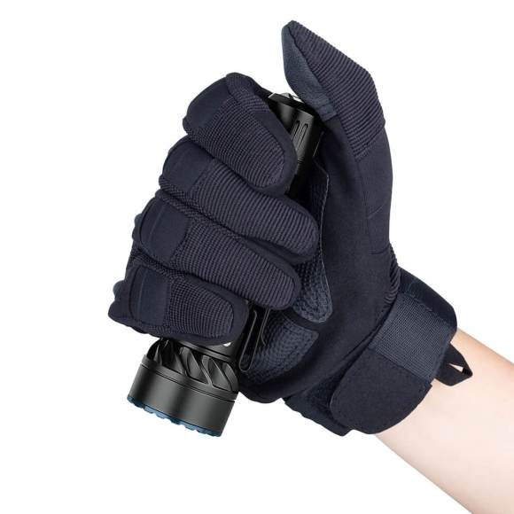 Olight Freyr held in a gloved hand with thumb on tail switch