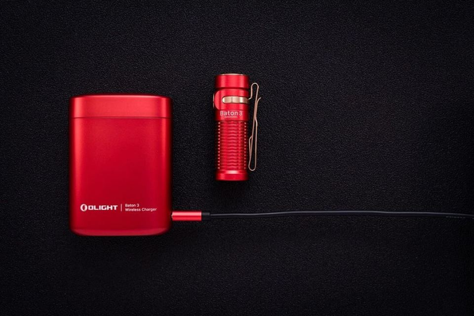 Olight S1R Baton 3 in red with the charging case plugged in