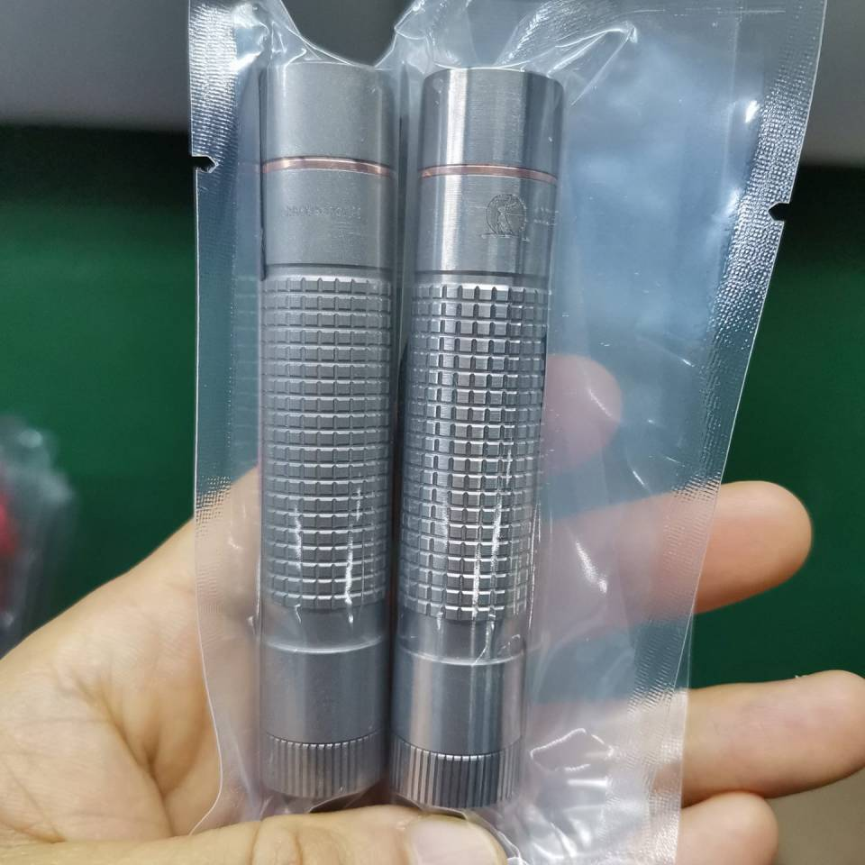 Lumintop EDCAA pocket flashlights  in titanium and neutral white