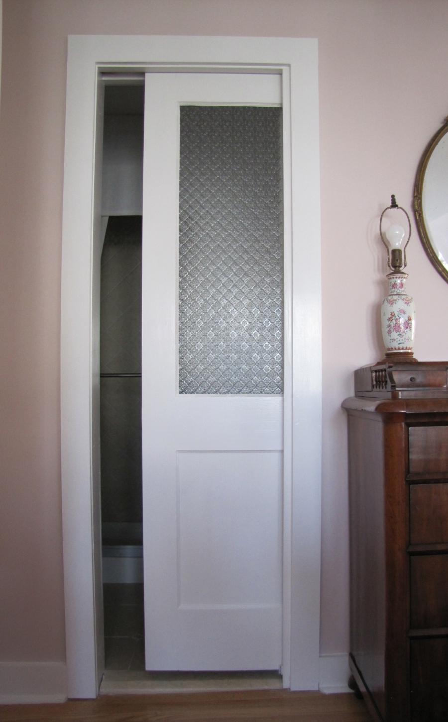 Show me photos of pocket doors for bathrooms