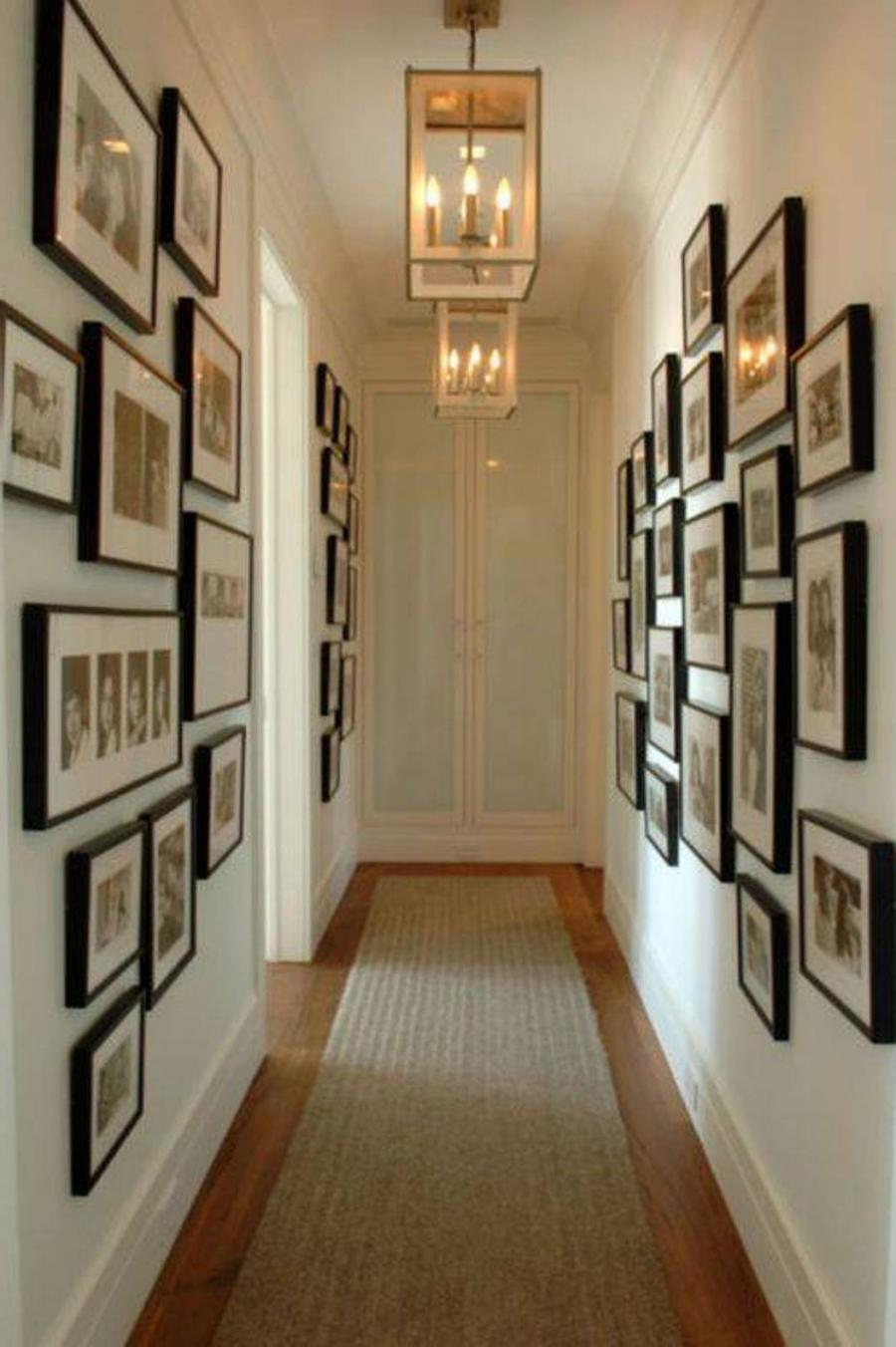 Hanging photos on a hallway wall