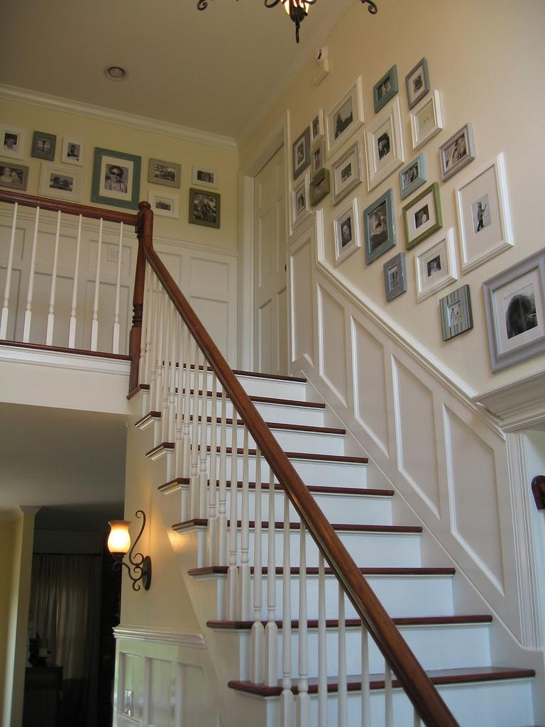 Hanging photos going up stairs