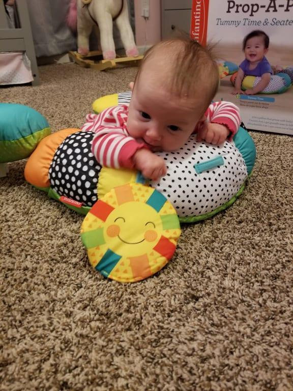 prop a pillar tummy time seated