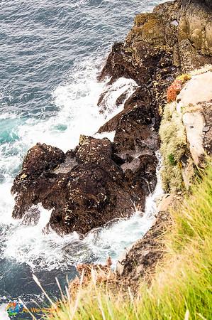 Waves crash at Irish cliffs