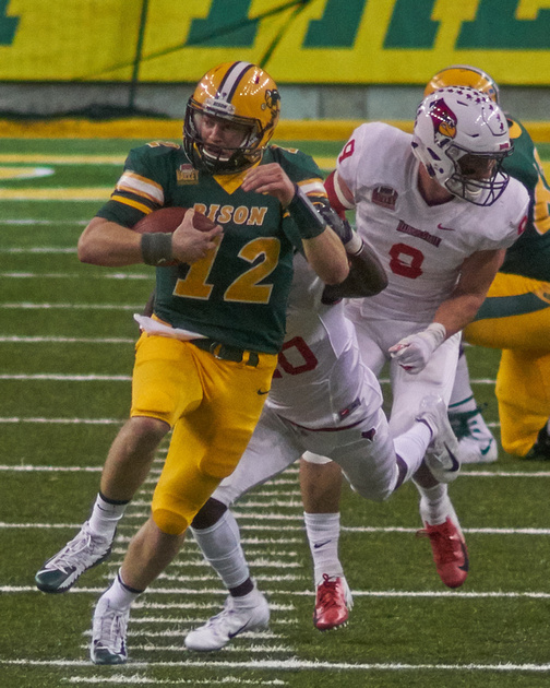 NDSU QB #12 Easton Stick runs 20 yards to the Illinois 38 before hes tackled by CB #20 Willie Edwards and FS #14 Luther Kirk. It was Third and 3 at NDSU 42, on the last play of the 3rd Quarter. -<small>Photo DSC05524 by Craig Maas</small>