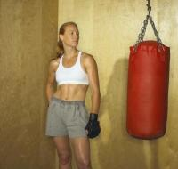 Abdominal Workout With a Punching Bag - Woman