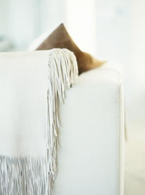 folding travel chair light pink accent the best ways to drape a blanket on couch | home guides sf gate