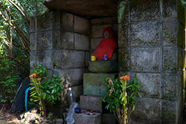 Passing by a local jizo statue and shrine.