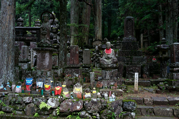 Many jizo statues lined up to watch over people.