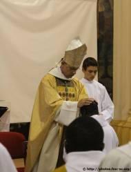 Imposition des mains par l'évêque