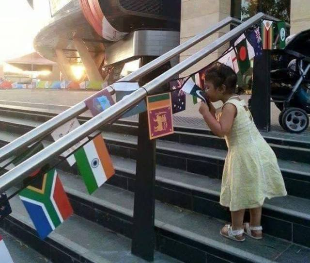 Little Girl Kissing Pakistani Flag On Stairs