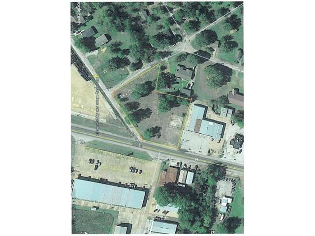 1.31 acres - heavy traffic count and good access to this nice corner property!  Lots of Possibilities!