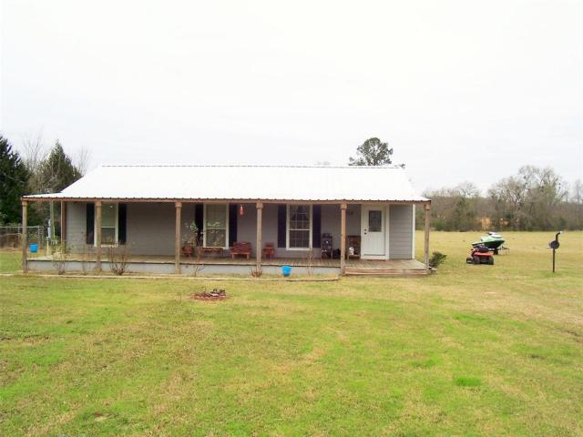 This inviting home has 3 bedrooms and 2 baths with a large open concept living/dining/kitchen area. The master bedroom has its own bath with tub and shower. There is a large 12'x50' front porch across the front of the house and a covered area at the back door. Give us a call to see this property!